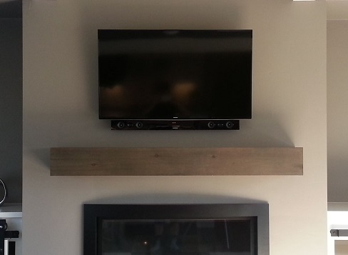TV mount service over fireplace in newport beach