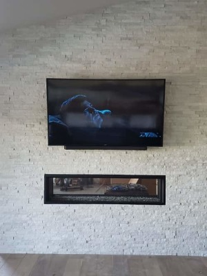 TV Mounted on a white stone fireplace in cerritos,ca